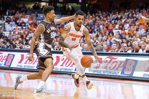 Jaylen Adams of the St Bonaventure Bonnies defends as Michael Gbinije of the Syracuse Orange moves the ball during the first half on November 17 2015...
