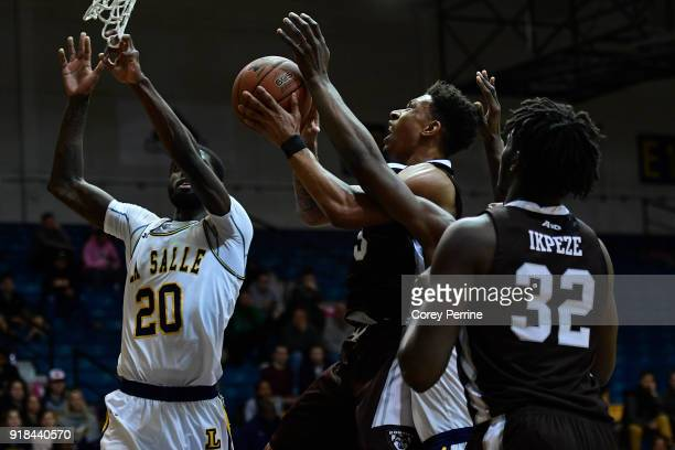 Jaylen Adams of the St Bonaventure Bonnies drives to the basket against BJ Johnson of the La Salle Explorers during the first half at Tom Gola Arena...