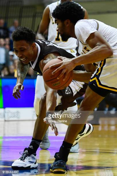 Jaylen Adams of the St Bonaventure Bonnies reaches in on Pookie Powell of the La Salle Explorers during the first half at Tom Gola Arena on February...
