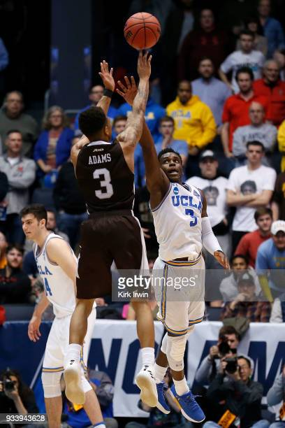 Jaylen Adams of the St Bonaventure Bonnies shoots the ball over the defense of Aaron Holiday of the UCLA Bruins during the game at UD Arena on March...