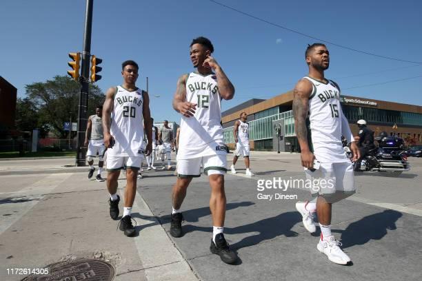 Jaylen Adams Rayjon Tucker and Frank Mason of the Milwaukee Bucks arrive before media day on September 30 2019 at the Fiserv Forum in Milwaukee...