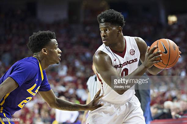 Jaylen Barford of the Arkansas Razorbacks looks to make a pass while being defended by Antonio Blakeney of the LSU Tigers at Bud Walton Arena on...