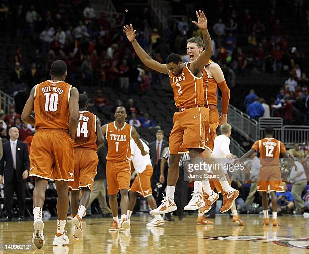 Jaylen Bond and Clint Chapman of the Texas Longhorns celebrate after the Longhorns defeated the Iowa State Cyclones to win the NCAA Big 12 basketball...