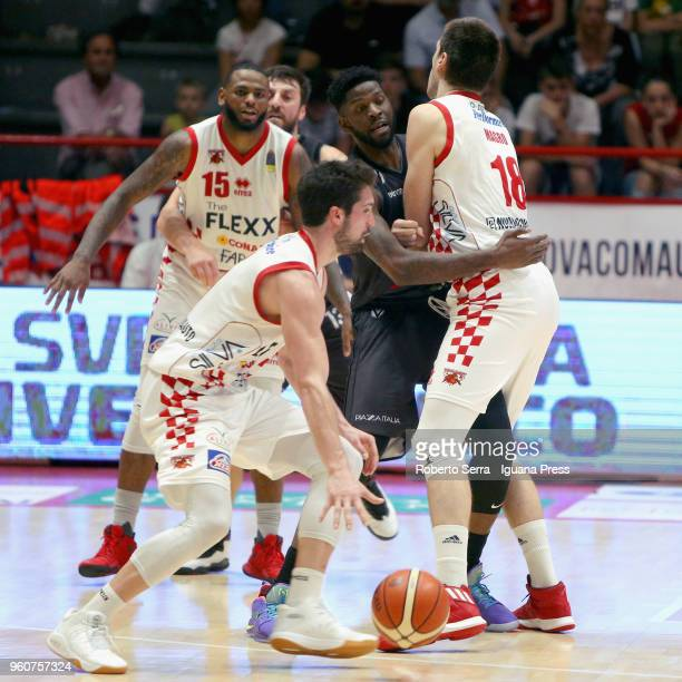 Jaylen Bond and Fabio Mian and Daniele Magro of The Flexx competes with Klaudio Ndoja and Jamil Wilson of Segafredo during the LBA LegaBasket match...
