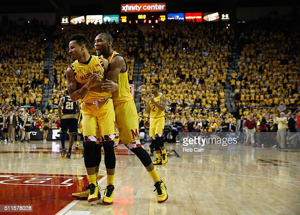 Jaylen Brantley and Rasheed Sulaimon of the Maryland Terrapins celebrate after defeating the Michigan Wolverines 8682 at Xfinity Center on February...