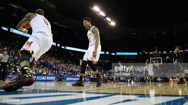Jaylen Brantley of the Maryland Terrapins and Rasheed Sulaimon of the Maryland Terrapins celebrate a dunk in the closing seconds of the Terrapins...