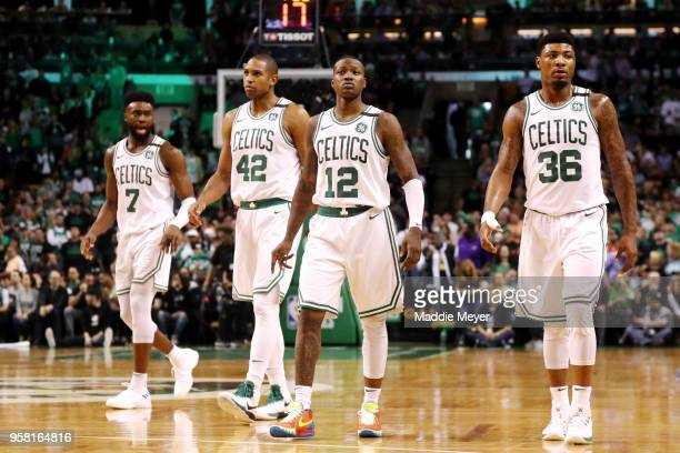 Jaylen Brown Al Horford Terry Rozier and Marcus Smart of the Boston Celtics walk back on the court after a timeout against the Cleveland Cavaliers...
