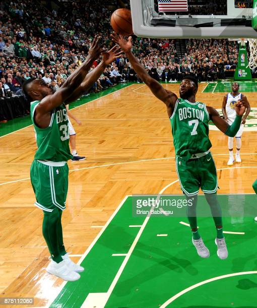 Jaylen Brown and Semi Ojeleye of the Boston Celtics grabs the rebound against the Golden State Warriors on November 16 2017 at the TD Garden in...