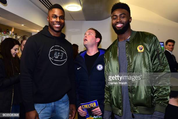 Jaylen Brown and Semi Ojeleye of the Boston Celtics pose for a photo with Peter Dale aka Tubes from Soccer AM during the Carabao Cup SemiFinal First...