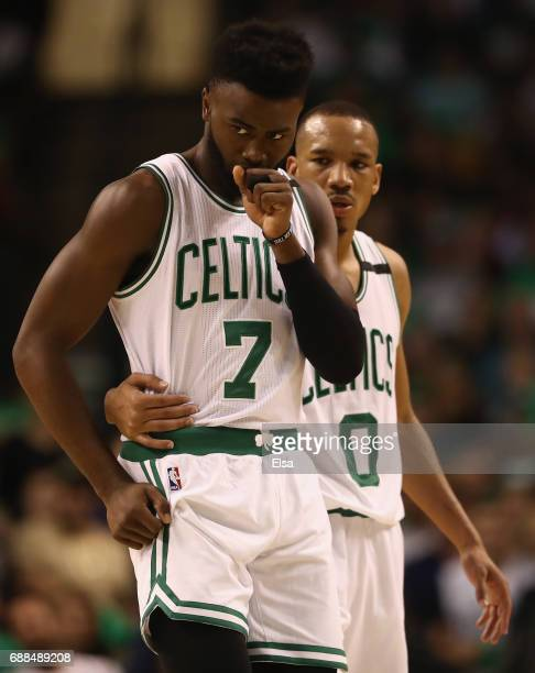 Jaylen Brown is consoled by Avery Bradley of the Boston Celtics in the third quarter against the Cleveland Cavaliers during Game Five of the 2017 NBA...