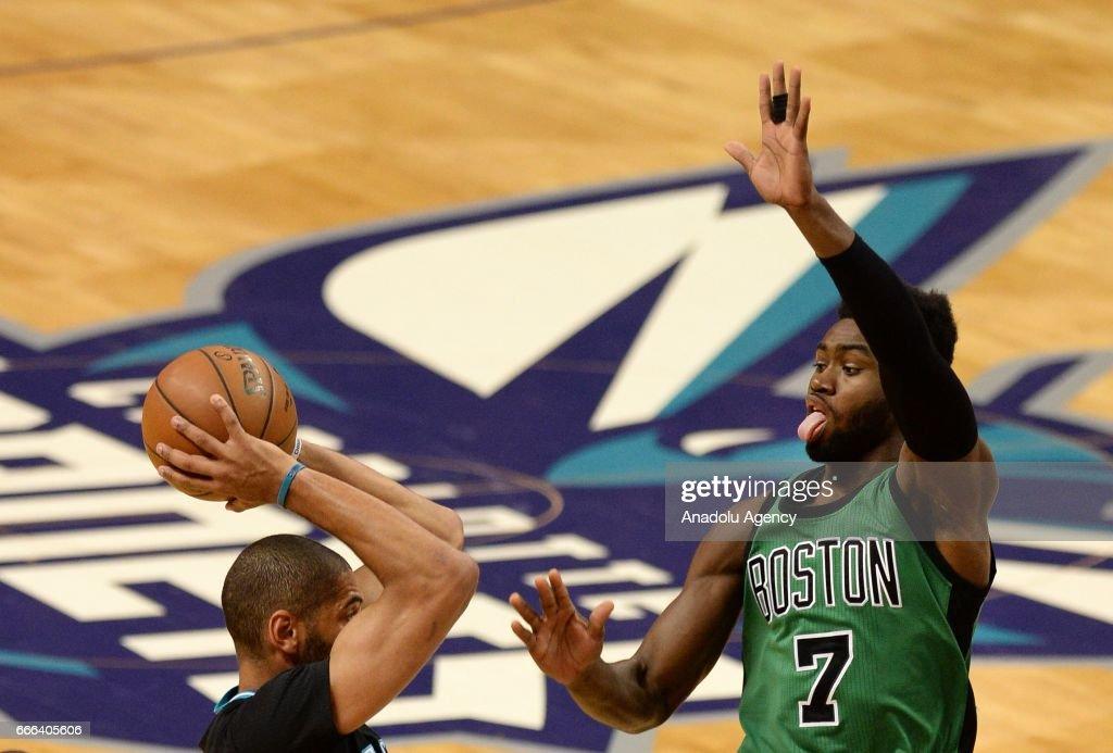 Jaylen Brown (R) of Boston Celtics blocks during the NBA match between Boston Celtics vs Charlotte Hornets at the Spectrum arena in Charlotte, NC, United States on April 8, 2017.