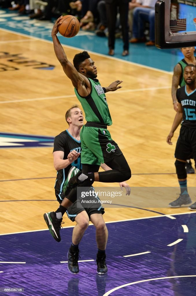 Jaylen Brown (front) of Boston Celtics jumps to score during the NBA match between Boston Celtics vs Charlotte Hornets at the Spectrum arena in Charlotte, NC, United States on April 8, 2017.