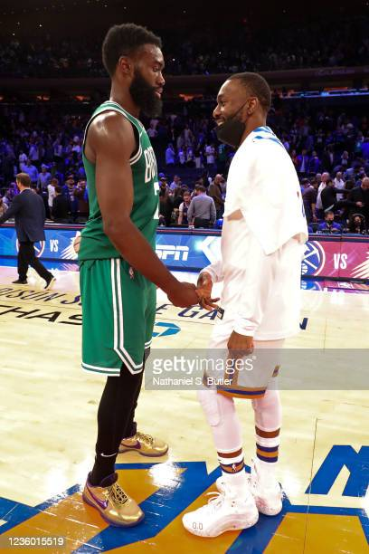 Jaylen Brown of the Boston Celtics and Kemba Walker of the New York Knicks talk on court after the game on October 20, 2021 at Madison Square Garden...