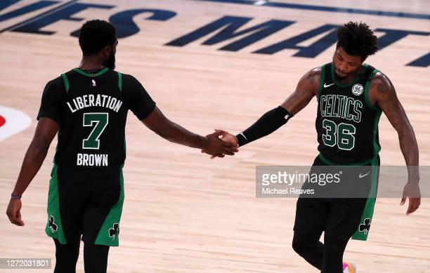 Jaylen Brown of the Boston Celtics and Marcus Smart of the Boston Celtics react during the fourth quarter against the Toronto Raptors in Game Seven...