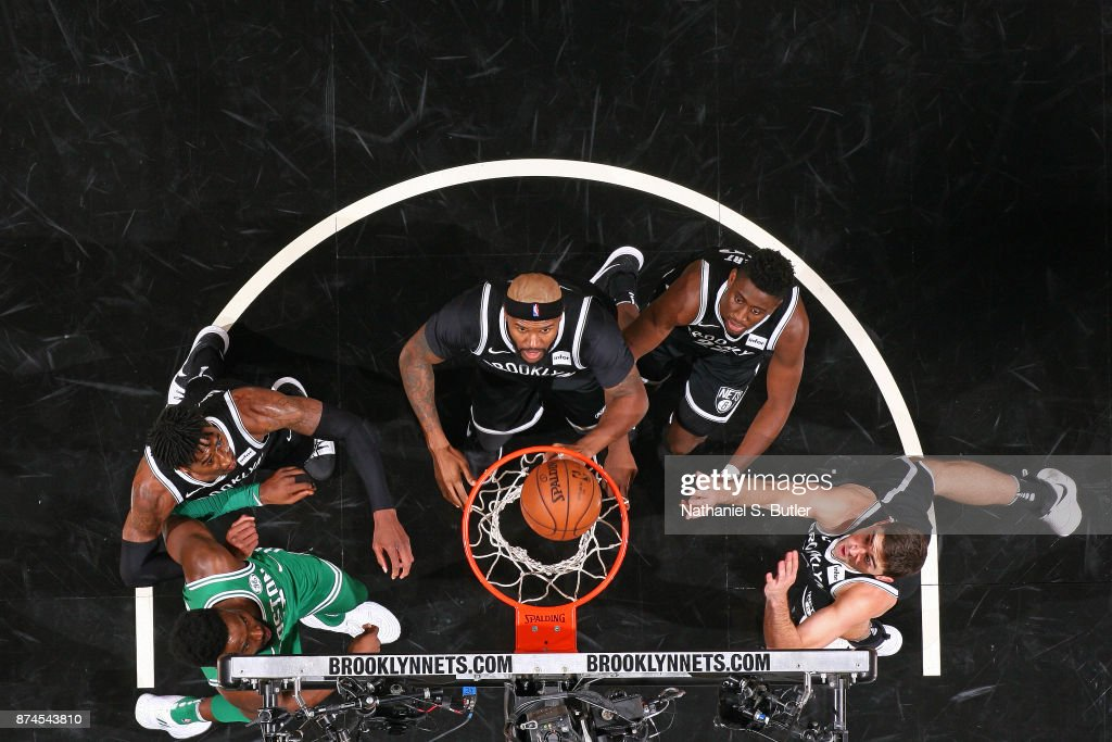Jaylen Brown #7 of the Boston Celtics and Rondae Hollis-Jefferson #24, Trevor Booker #35, Caris LeVert #22 and Joe Harris #12 of the Brooklyn Nets wait for a rebound on November 14, 2017 at Barclays Center in Brooklyn, New York.