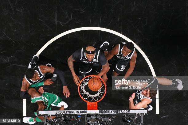 Jaylen Brown of the Boston Celtics and Rondae HollisJefferson Trevor Booker Caris LeVert and Joe Harris of the Brooklyn Nets wait for a rebound on...