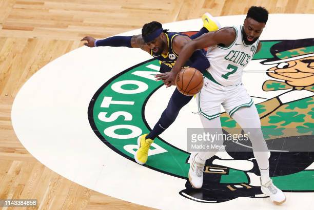 Jaylen Brown of the Boston Celtics and Wesley Matthews of the Indiana Pacers battle for a loose ball during the first quarter of Game Two of Round...