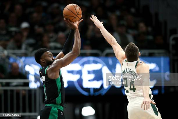 Jaylen Brown of the Boston Celtics attempts a shot while being guarded by Pat Connaughton of the Milwaukee Bucks in the fourth quarter during Game...