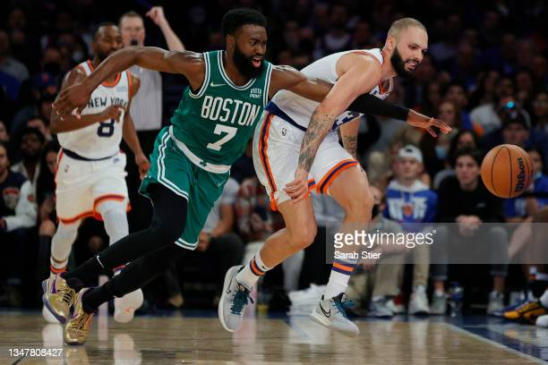 Jaylen Brown of the Boston Celtics attempts to steal the ball from Evan Fournier of the New York Knicks during the second half at Madison Square...