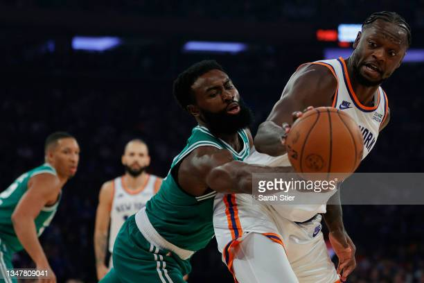 Jaylen Brown of the Boston Celtics attempts to steal the ball from Julius Randle of the New York Knicks during the first half at Madison Square...