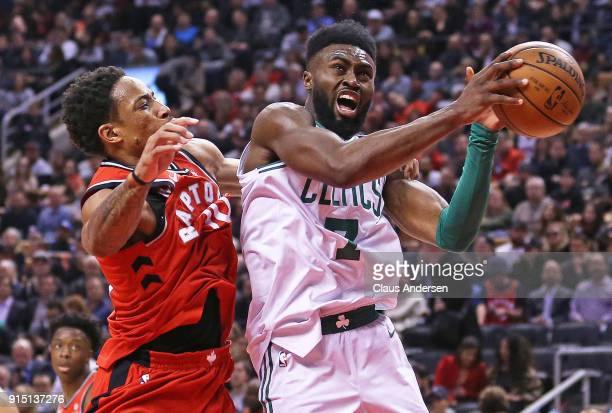 Jaylen Brown of the Boston Celtics battles against DeMar DeRozan of the Toronto Raptors in an NBA game at the Air Canada Centre on February 6 2018 in...