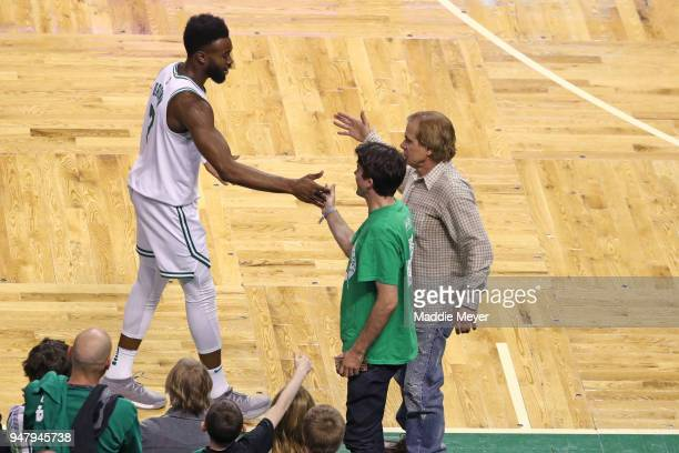 Jaylen Brown of the Boston Celtics celebrates with fans in the fourth quarter of Game Two in Round One of the 2018 NBA Playoffs against the Milwaukee...