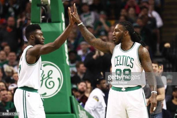 Jaylen Brown of the Boston Celtics celebrates with Jae Crowder after hitting a three point shot against the Atlanta Hawks during the first quarter at...