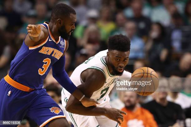 Jaylen Brown of the Boston Celtics drives against Tim Hardaway Jr #3 of the New York Knicks during the first half at TD Garden on October 24 2017 in...