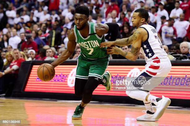 Jaylen Brown of the Boston Celtics drives against Trey Burke of the Washington Wizards in the second half in Game Four of the Eastern Conference...