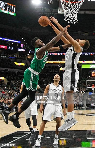 Jaylen Brown of the Boston Celtics drives on Kyle Anderson of the San Antonio Spursat ATT Center on December 14 2016 in San Antonio Texas NOTE TO...