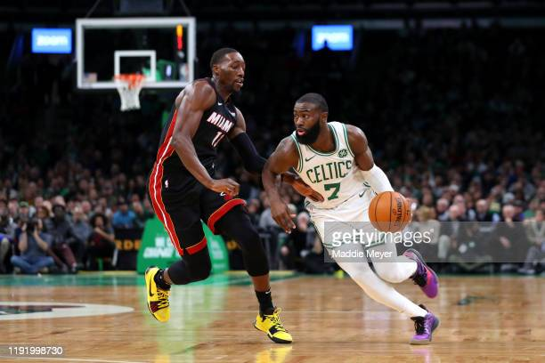 Jaylen Brown of the Boston Celtics drives past Bam Adebayo of the Miami Heat during the second half of the game between the Boston Celtics and the...