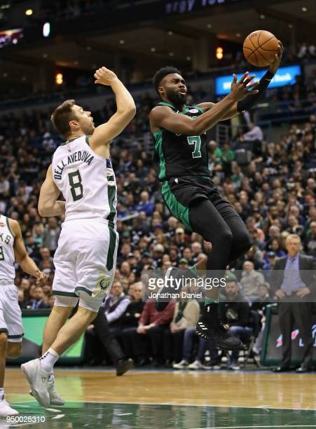 Jaylen Brown of the Boston Celtics drives past Matthew Dellavedova of the Milwaukee Bucks during Game Four of Round One of the 2018 NBA Playoffs at...