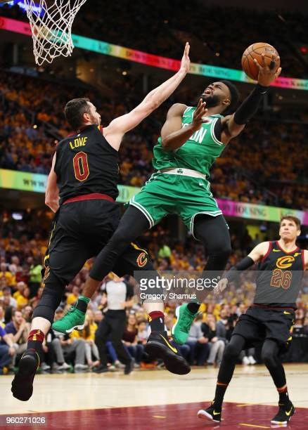 Jaylen Brown of the Boston Celtics drives to the basket against Kevin Love of the Cleveland Cavaliers in the second half during Game Three of the...