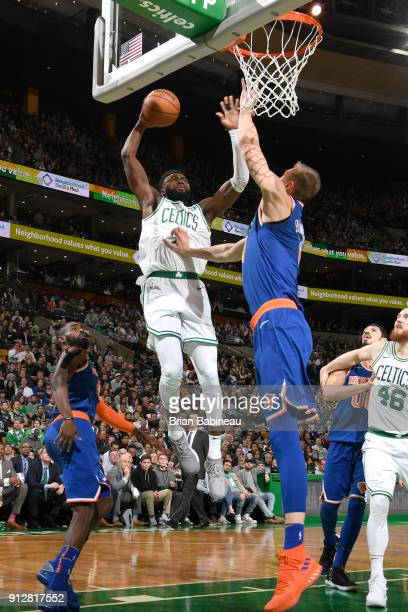 Jaylen Brown of the Boston Celtics drives to the basket against Kristaps Porzingis of the New York Knicks on January 31 2018 at the TD Garden in...