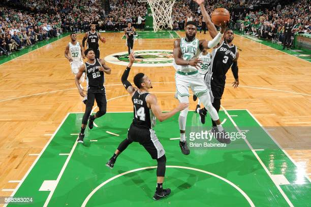 Jaylen Brown of the Boston Celtics drives to the basket against the San Antonio Spurs on October 30 2017 at the TD Garden in Boston Massachusetts...