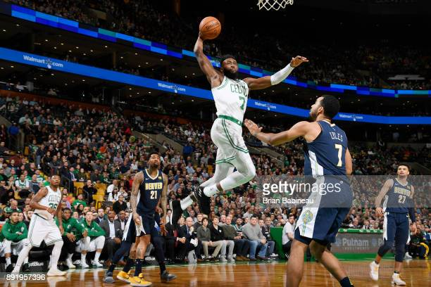 Jaylen Brown of the Boston Celtics drives to the basket against Trey Lyles of the Denver Nuggets on December 13 2017 at the TD Garden in Boston...