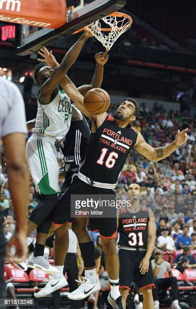 Jaylen Brown of the Boston Celtics dunks against and is fouled by Josh Scott of the Portland Trail Blazers during the 2017 Summer League at the...