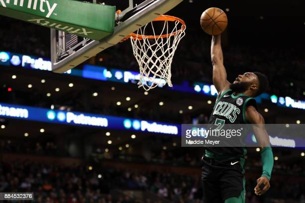 Jaylen Brown of the Boston Celtics dunks during the first half against the Phoenix Suns at TD Garden on December 2 2017 in Boston Massachusetts