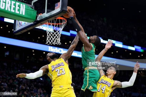 Jaylen Brown of the Boston Celtics dunks over LeBron James and Danny Green of the Los Angeles Lakers at TD Garden on January 20 2020 in Boston...