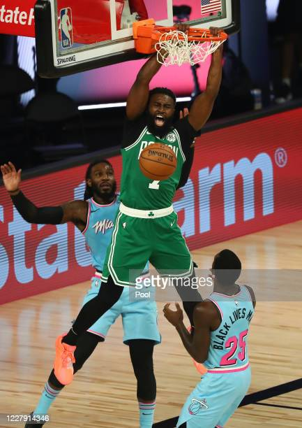 Jaylen Brown of the Boston Celtics dunks the ball against Jae Crowder of the Miami Heat in the second half of an NBA game at HP Field House at ESPN...