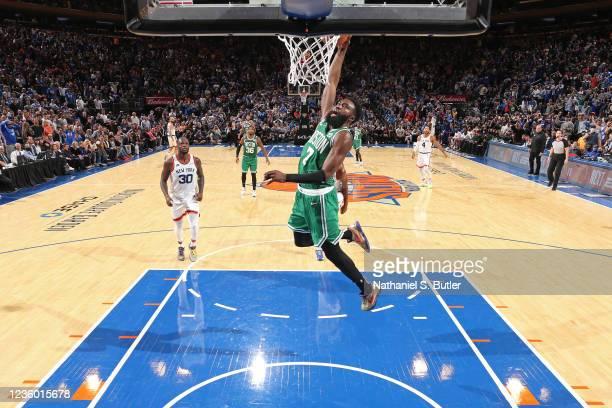 Jaylen Brown of the Boston Celtics dunks the ball against the New York Knicks on October 20, 2021 at Madison Square Garden in New York, New York....