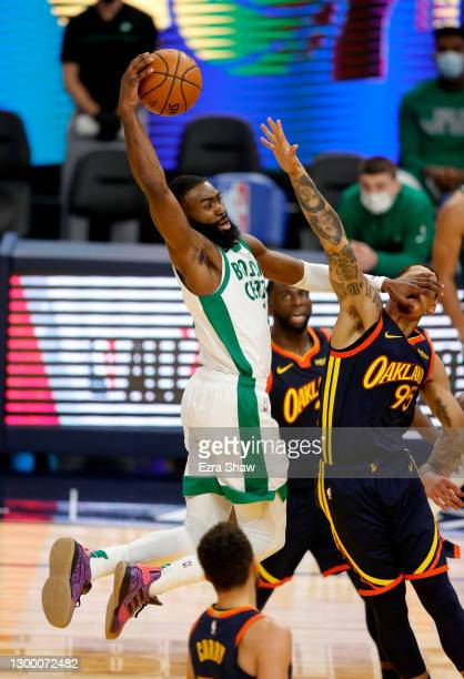 Jaylen Brown of the Boston Celtics dunks the ball on Juan Toscano-Anderson of the Golden State Warriors at Chase Center on February 02, 2021 in San...