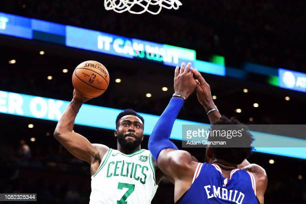 Jaylen Brown of the Boston Celtics dunks the ball over Joel Embiid of the Philadelphia 76ers during a game at TD Garden on October 16 2018 in Boston...