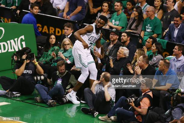 Jaylen Brown of the Boston Celtics falls into New England Patriots owner Robert Kraft during Game Five of the 2018 NBA Eastern Conference Finals...