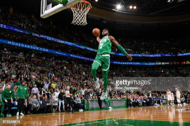 Jaylen Brown of the Boston Celtics goes in to dunk the ball against the Golden State Warriors on November 16 2017 at the TD Garden in Boston...