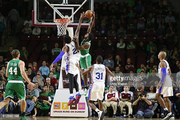 Jaylen Brown of the Boston Celtics goes up for a dunk against Joel Embiid of the Philadelphia 76ers during a preseason game on October 4 2016 at the...