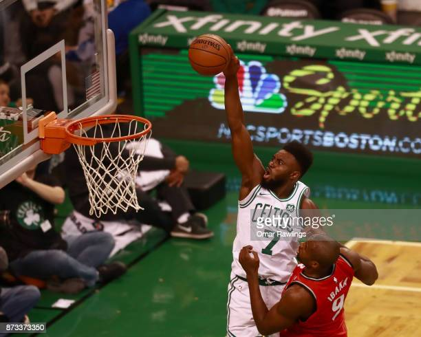 Jaylen Brown of the Boston Celtics goes up for a dunk over Serge Ibaka of the Toronto Raptors in the second quarter of the game at TD Garden on...
