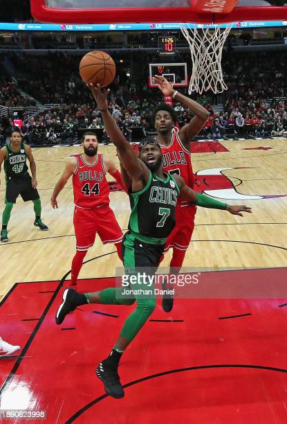 Jaylen Brown of the Boston Celtics goes up for a shot past Justin Holiday of the Chicago Bulls at the United Center on December 11 2017 in Chicago...