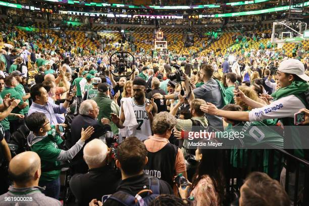 Jaylen Brown of the Boston Celtics high fives fans after defeating the Cleveland Cavaliers 9683 in Game Five of the 2018 NBA Eastern Conference...