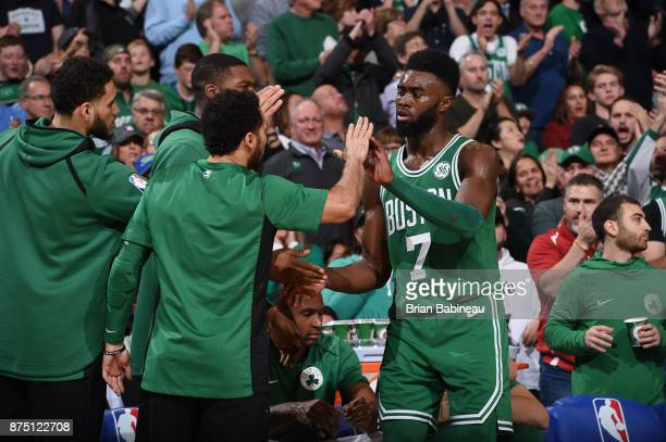 Jaylen Brown of the Boston Celtics high fives his teammates during the game against the Golden State Warriors on November 16 2017 at the TD Garden in...